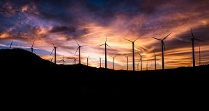 Texas Power to Choose | Energy Plans - image of windmills at night