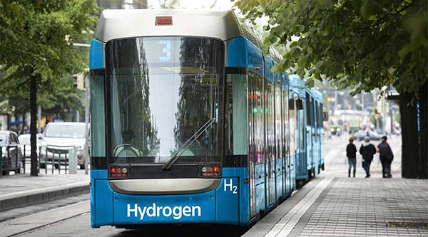 Bill Gates Fund Backs Green Hydrogen | image of bus with sign