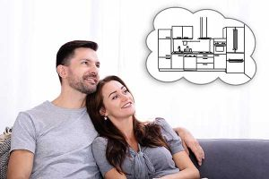 Energy-Efficient Products | Couple contemplating Savings