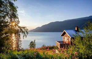 Sustainable Building Design | Outside image of House next to Lake