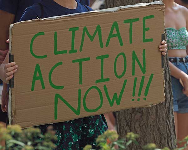 U.S. Climate Ambition Urged Action on Climate Changes | Boy holding sign