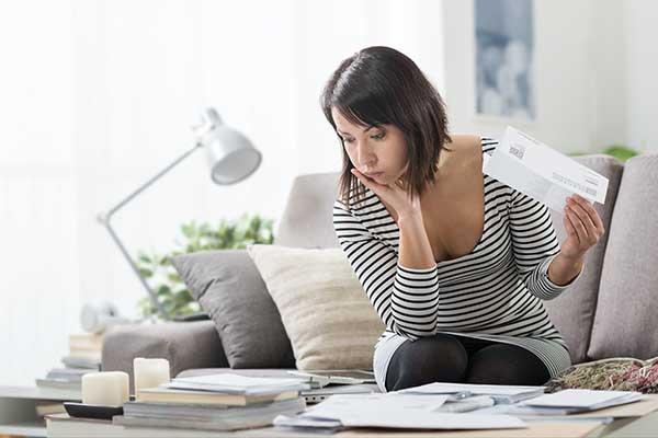 Electricity Bills in Texas | Woman Planning Finances